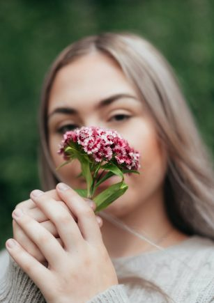 female smelling fresh flowers turkish carnation